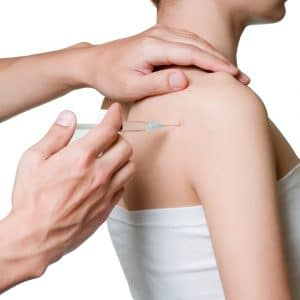 Shoulder pain treatment on woman receiving stem cell therapy injection