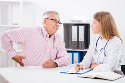 male patient talking to his doctor about his hip pain