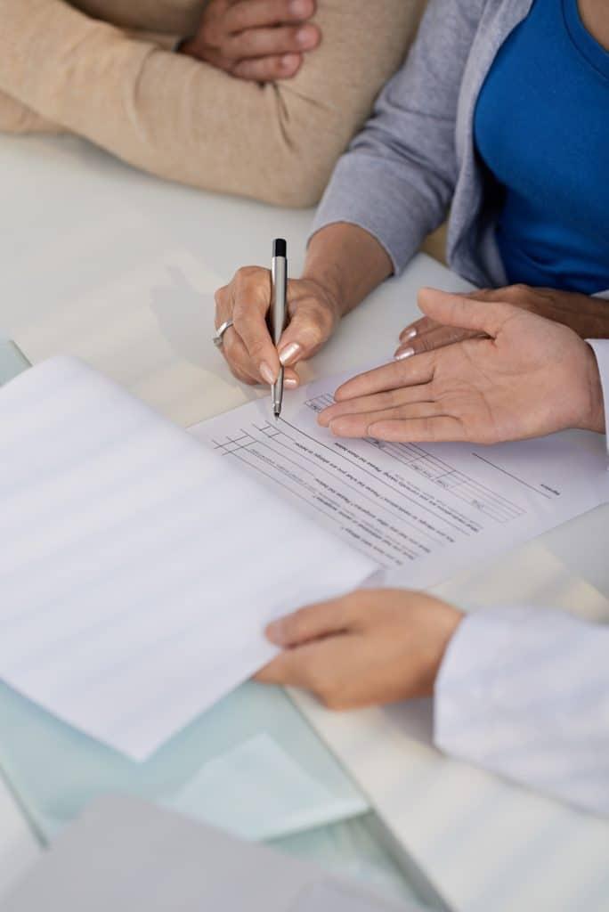 doctor showing patients medical paperwork