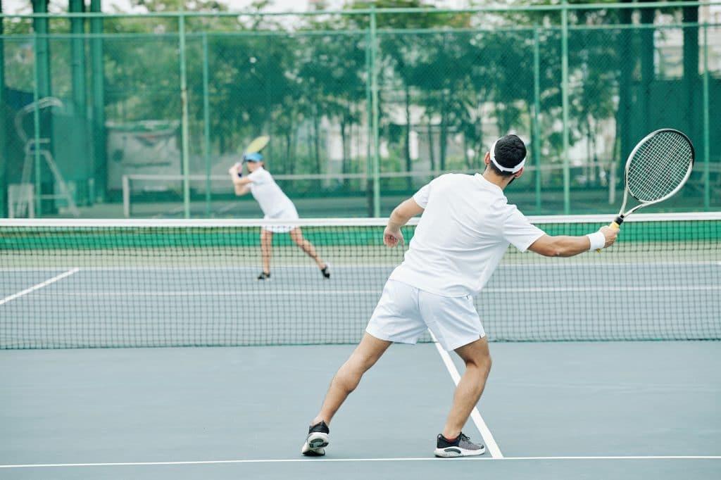 2 people playing tennis